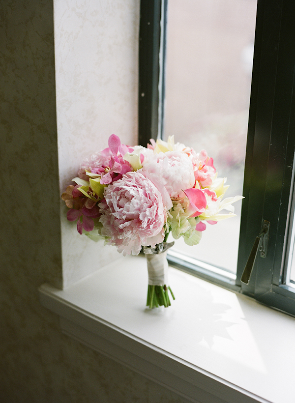 light and dark pink bouquet in a window - sweet southern military style wedding photo by Charleston wedding photographer Virgil Bunao