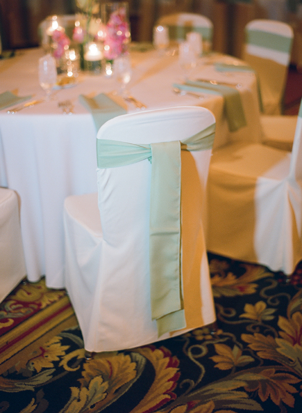light green cloth ties on chair backs - sweet southern military style wedding photo by Charleston wedding photographer Virgil Bunao