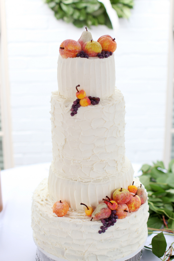 Ivory-colored wedding cake topped with fruit - Wedding Photo by Whitebox Weddings