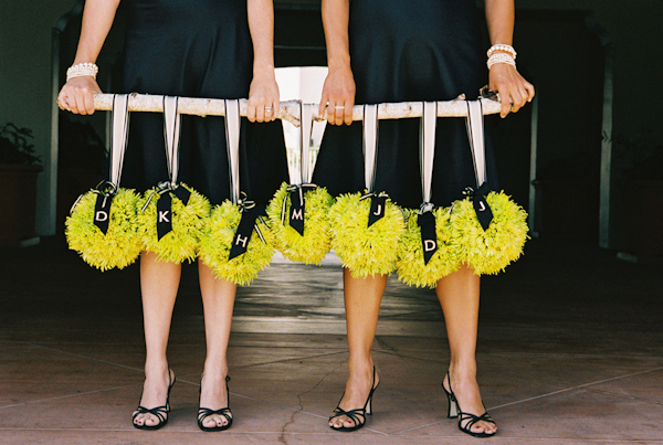 yellow and black wedding pomanders photo by Yvette Roman Photography