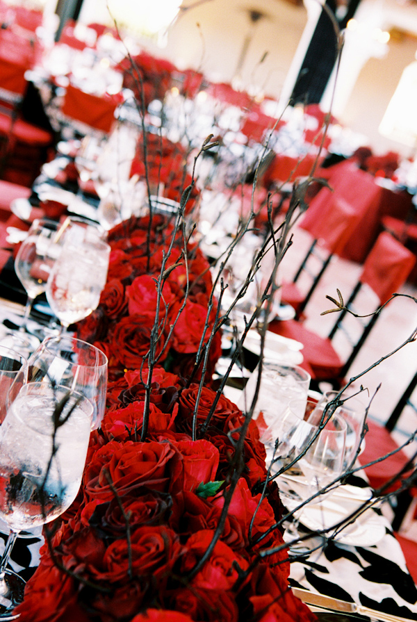 red rose and branch wedding centerpiece photo by Yvette Roman Photography