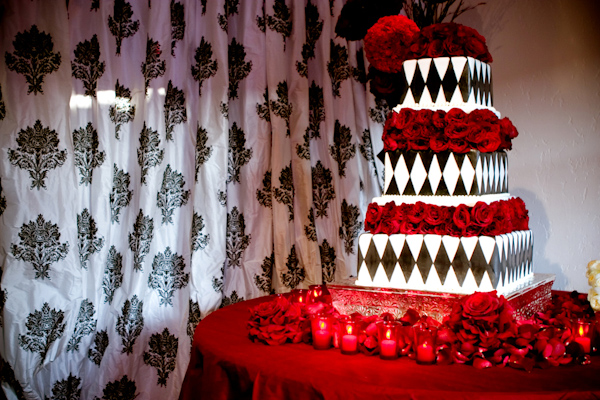 black, white and red wedding cake photo by Yvette Roman Photography