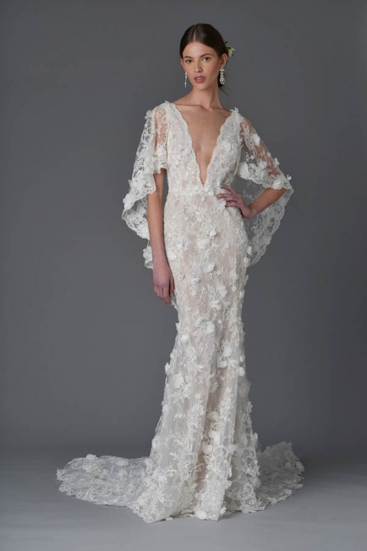Marchesa - Spring and Summer 2017 Bridal Collection - Fit and flare plunging v-neck gown with detachable cape flutter sleeve in re-embroidered lace with all-over 3D organza flowers