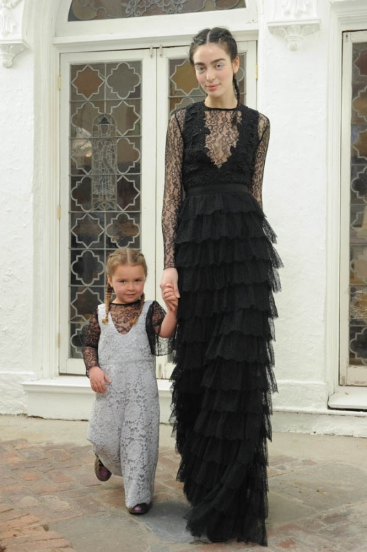 Houghton - Spring and Summer 2017 - Presley girls romper in dove grey French Guipure lace over Lily black Chantilly lace bodysuit with single flutter sleeve. Penelope black gown with French Guipure lace bodice and layers of French