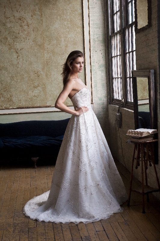 Enaura Bridal Couture - Spring 2014 Bridal Collection - Strapless full A-line gown with dipped neckline and natural waist; fully hand-beaded throughout</p>