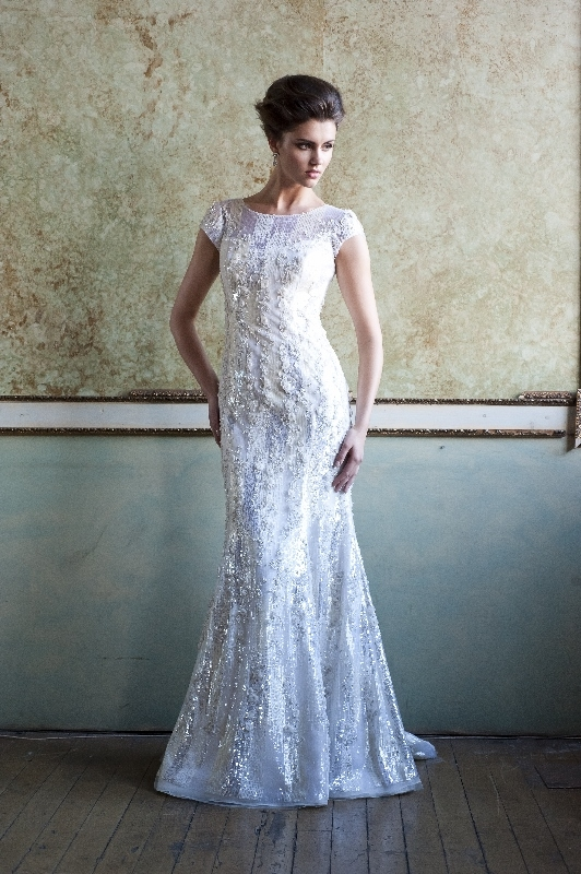 Enaura Bridal Couture - Spring 2014 Bridal Collection - Fit and flare gown with an illusion neckline, cap sleeves, scoop back and hand beaded sequins throughout</p>