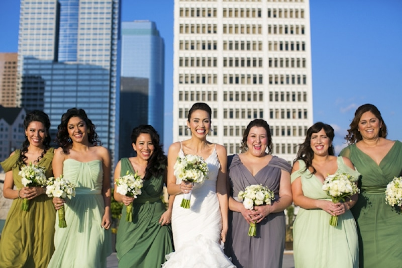 shades of green bridesmaid dresses at eco-friendly Jewish wedding at AT&T Center, Los Angeles, photo by Callaway Gable