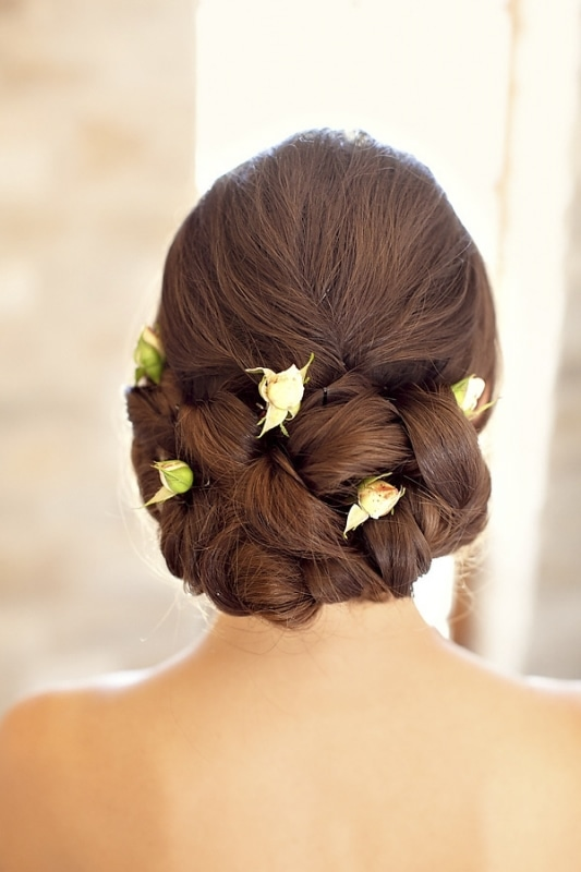 braided brides updo with white roses for vineyard wedding at Sunstone Winery, photo by Ashleigh Taylor Photography