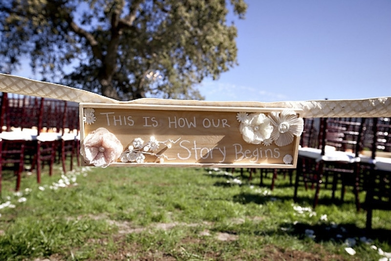 ceremony aisle signage at vineyard wedding at Sunstone Winery, photo by Ashleigh Taylor Photography