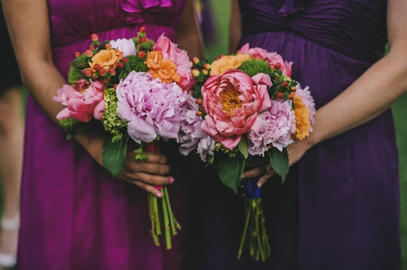 purple and pink bridesmaids bouquets, photo by The Oberports