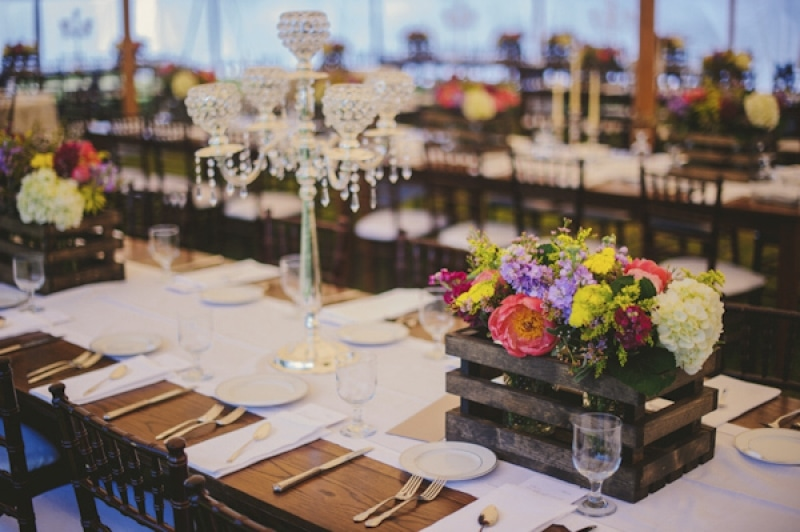 reception seating with candleabras and rustic floral centerpieces, photo by The Oberports