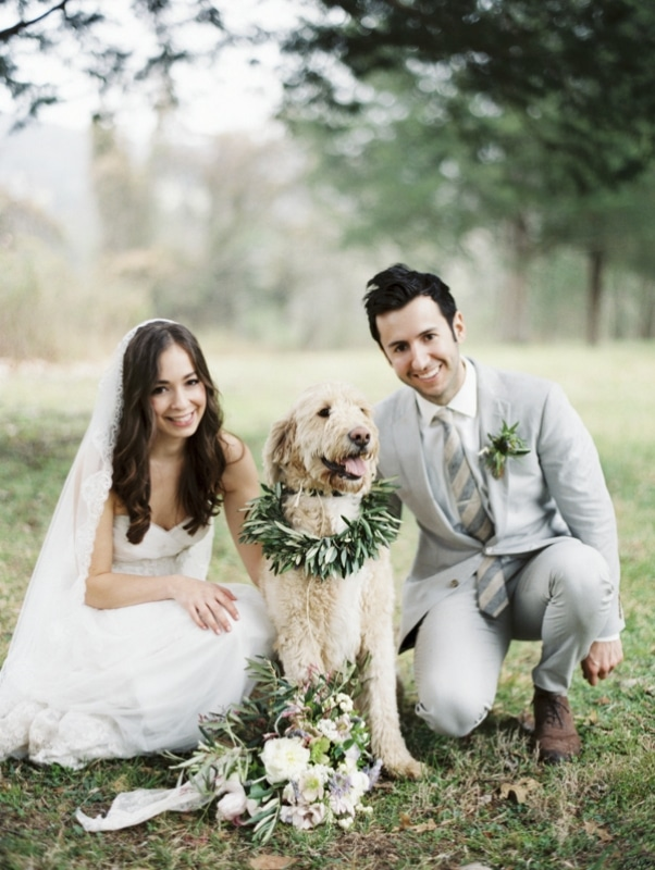 bride and groom with dog wearing garland, photo by Erich McVey Photography