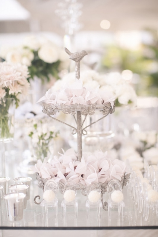 tiered silver stand holding confetti favors, photo by Melissa Jill Photography