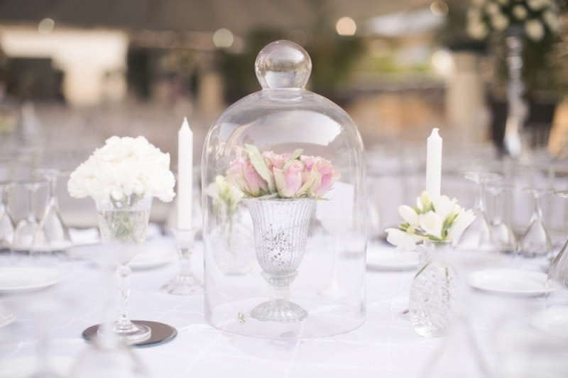 pink floral arrangement under glass cloche, photo by Melissa Jill Photography