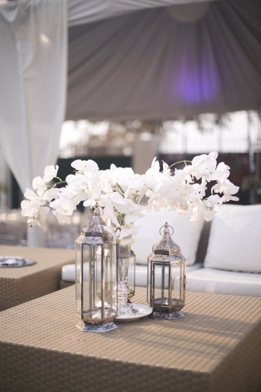 white orchids in lantern reception decor, photo by Melissa Jill Photography