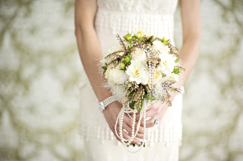 brides bouquet with white and green florals and white pearls, photo by Kristen Weaver Photography