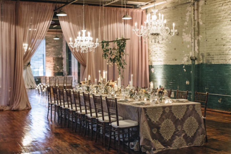 chandelier decor and table setting at wedding reception, photo by Vue Photography