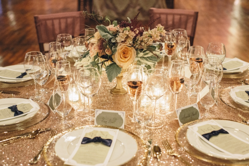 gold table top at wedding reception, photo by Vue Photography