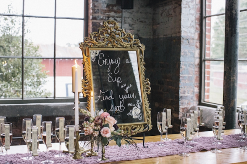 signage on mirror for escort cards, photo by Vue Photography