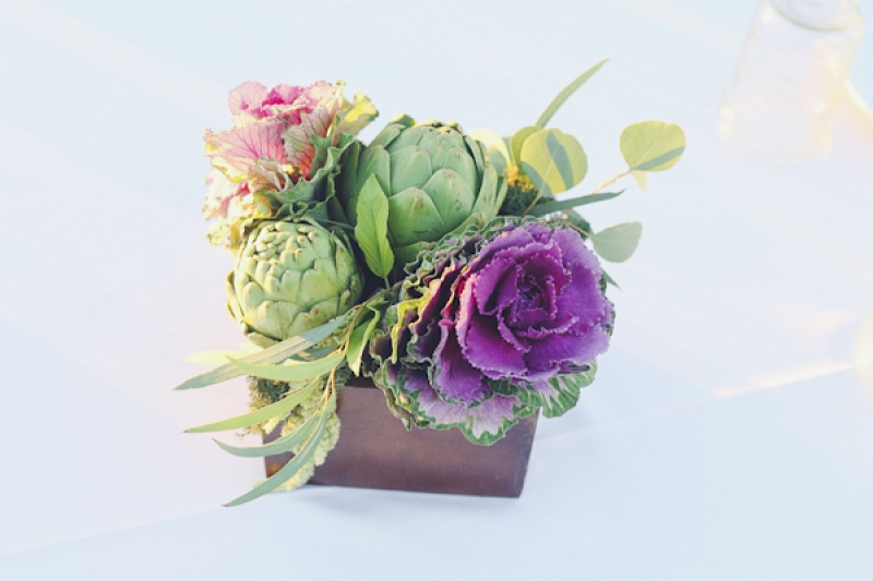 centerpiece with cabbage flower and artichokes, photo by Christina Carroll Photography