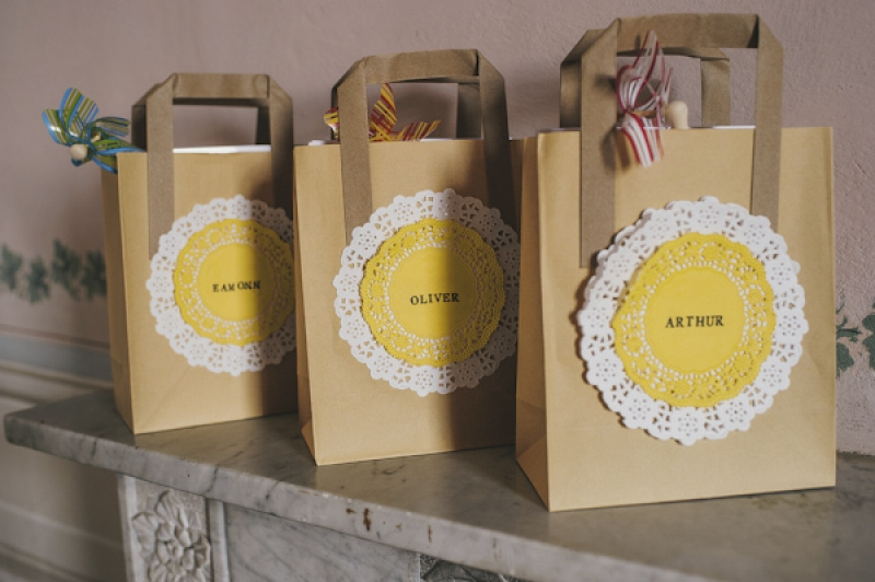 yellow and white lace doily gift bags, photo by This Modern Love