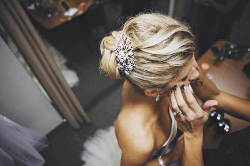 bridal hairstyle with silver hair accessory, photo by DWJohnson Studio