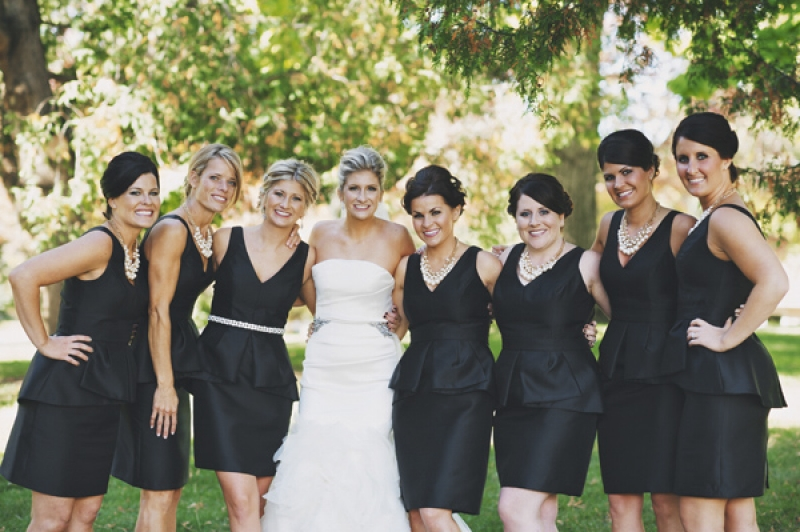 bridesmaids in black peplum dresses, photo by DWJohnson Studio