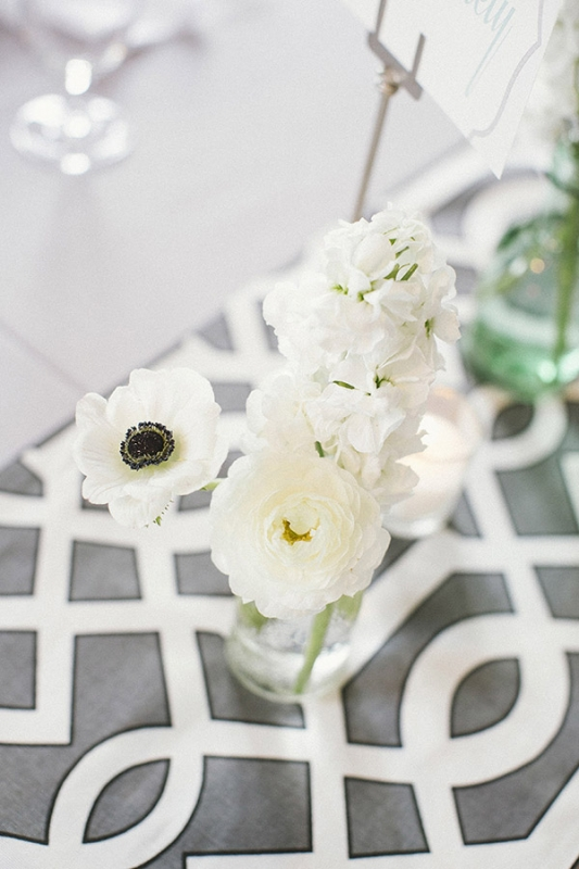 gray and white geometric table runner with white florals, photo by Paige Winn Photo