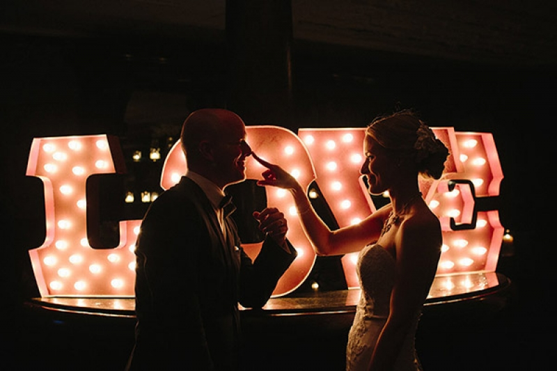 LOVE marquee sign at wedding reception, photo by Paige Winn Photo