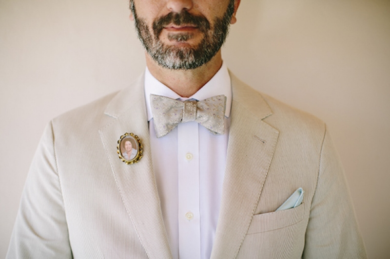groom in bow tie with teal handkerchief and small photo heirloom pin, photo by Adam Alex