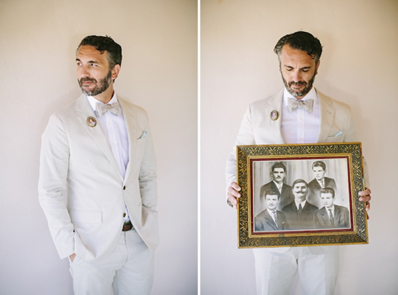 groom in light tan suit, with family heirloom portrait, photo by Adam Alex