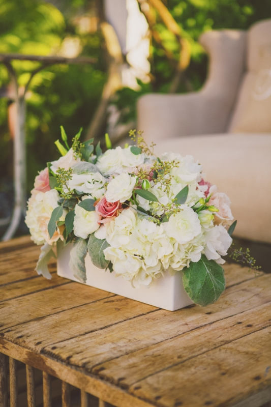 white and pink floral arrangement on rustic wood outdoor table, photo by Closer to Love Photography