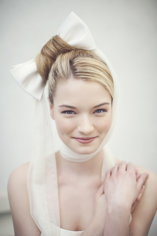 modern hairstyle with white bow, photo by Studio Uma