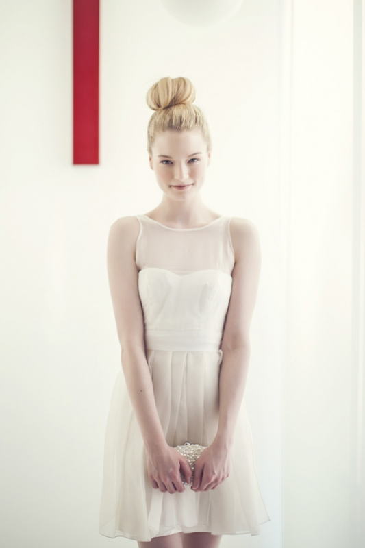 clean top-knot hairstyle and simple short white wedding dress, photo by Studio Uma