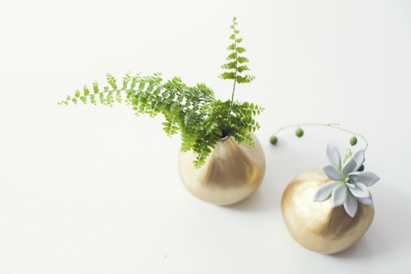 ferns and succulents in gold vases, photo by Studio Uma