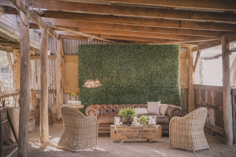 outdoor rustic lounge seating at wedding reception, photo by Studio Impressions