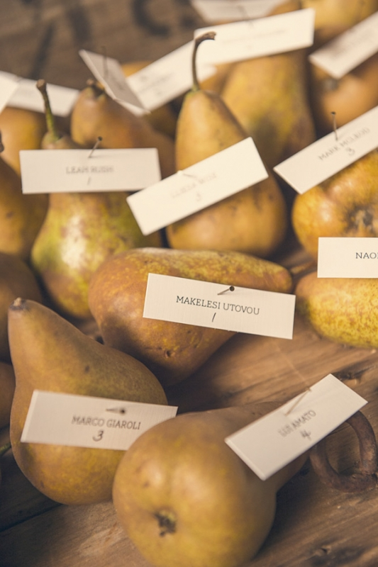 name escort cards pinned to pears, photo by Studio Impressions
