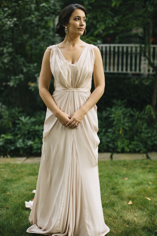 bride in blush draped long wedding dress, photo by Ely Brothers Studio