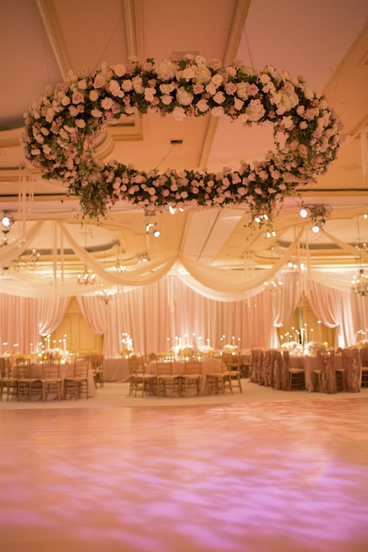large hanging floral arrangment with pink roses, photo by Ira Lippke Studios