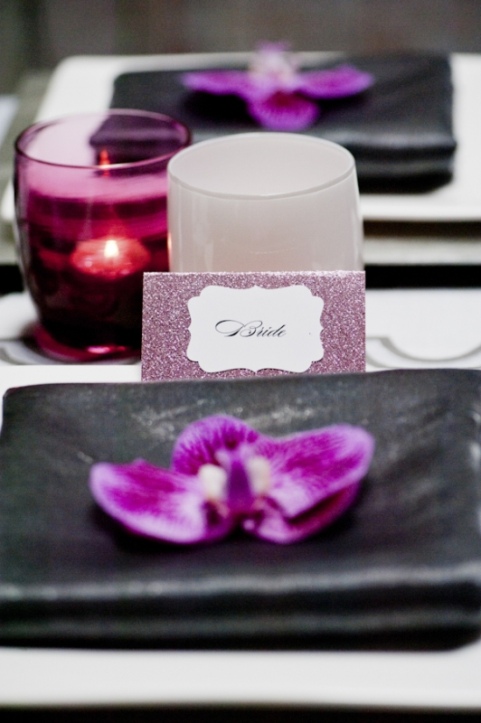 sparkly purple seating card and orchid at place setting, photo by Nikki Closser