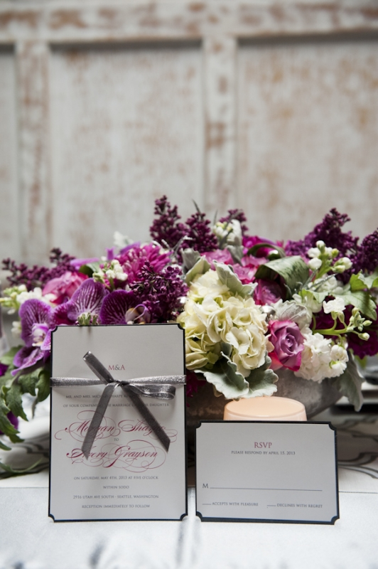 invitation suite and purple and pink floral centerpiece, photo by Nikki Closser