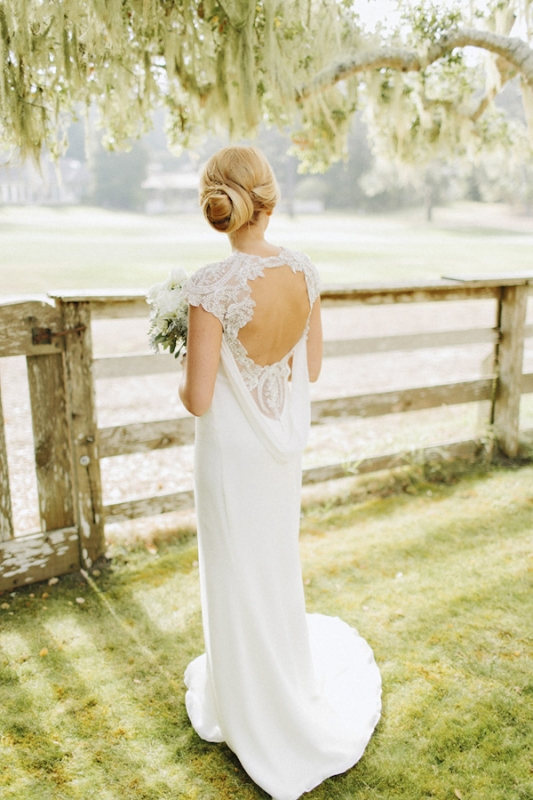 loose chignon hair style and open back wedding dress, photo by Benj Haisch