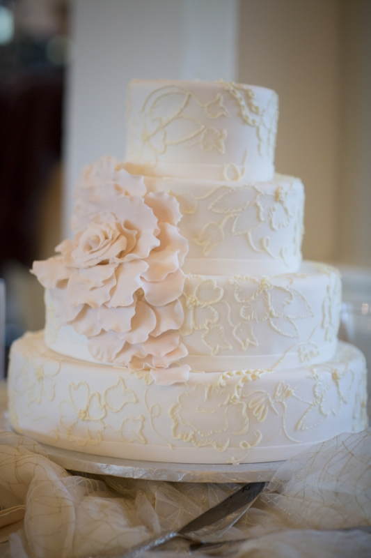 white tiered wedding cake with large white rose flower, photo by Asya Photography