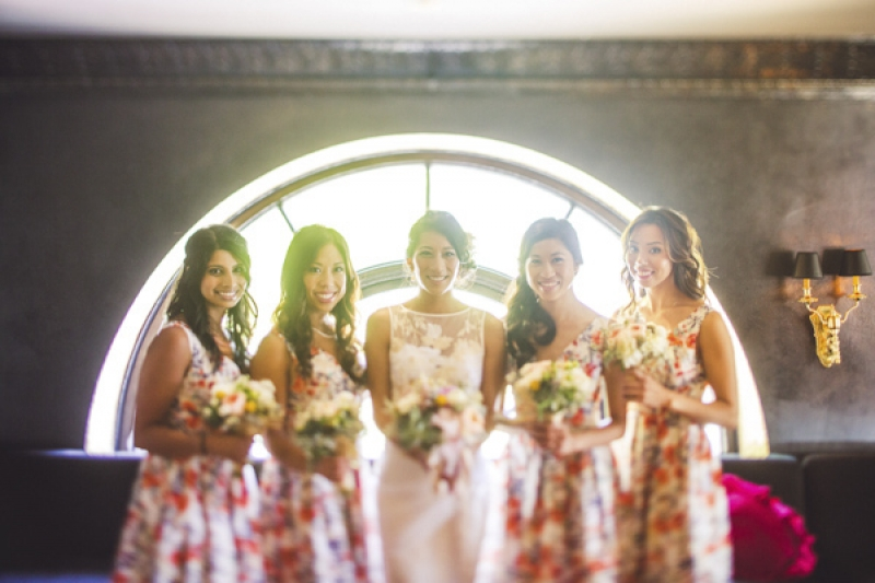 flowered bridesmaid dresses and sheath lace wedding dress, photo by Jeff Newsom