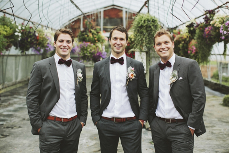 groom and groomsmen in gray suits with bowties, photo by Rowan Jane ...