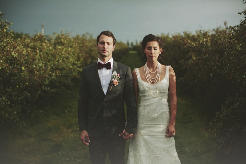 stylish bride and groom with bow tie and pearl necklace, photo by Rowan Jane Photography