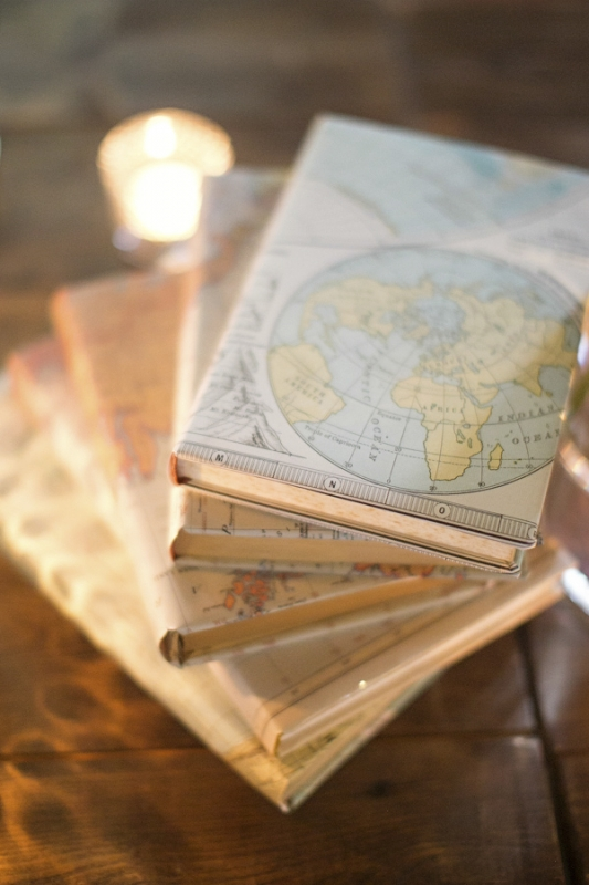 decor centerpieces with map covered books, photo by Paperlily Photography