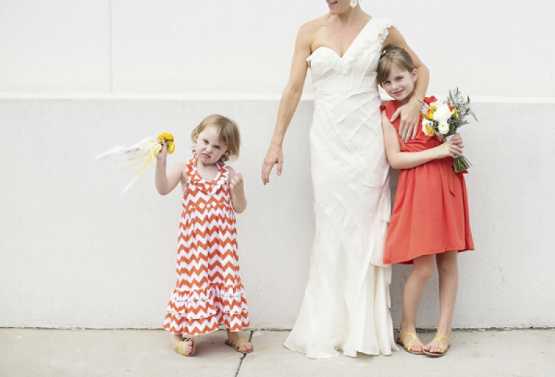 flowergirls in orange dresses, photo by Paperlily Photography