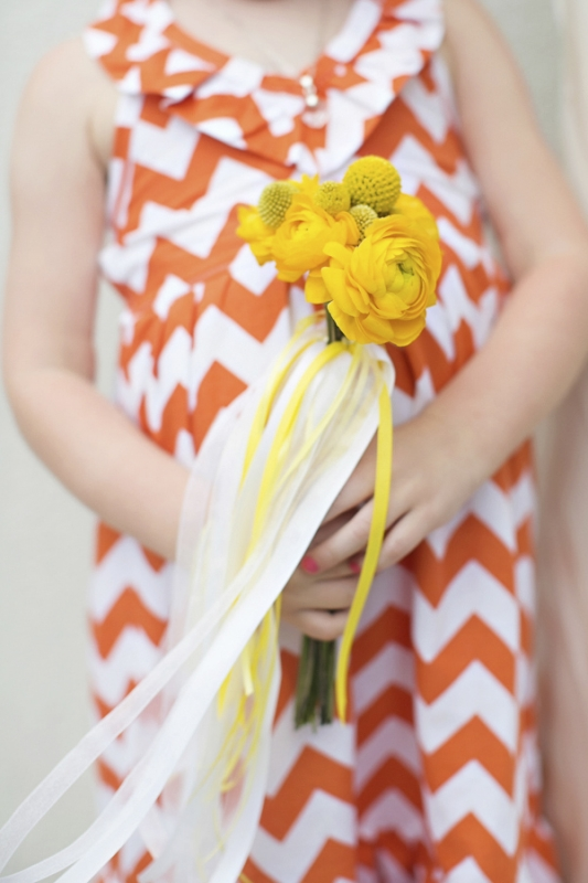 geometric orange flowergirl dress with yellow bouquet, photo by Paperlily Photography