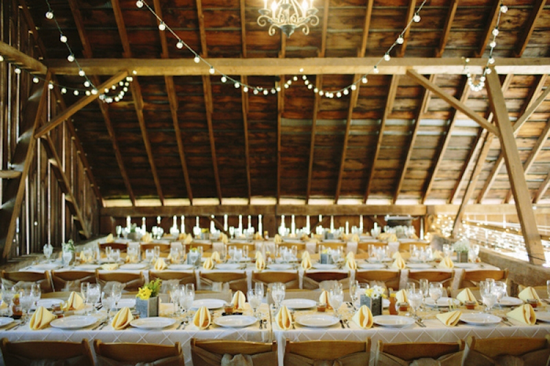 reception seating and place settings at barn wedding, photo by Dan Stewart Photography